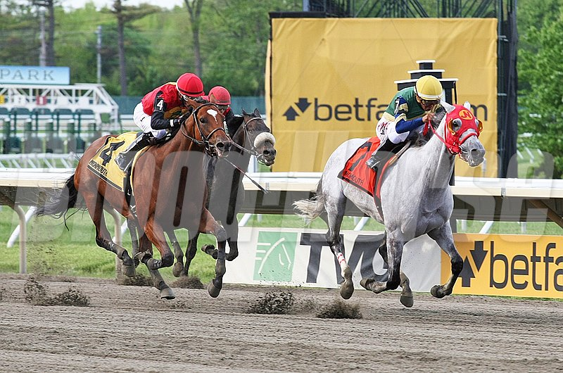 Delta Bluesman #7 (R) with Jonathan Gonzales riding lead at the finish of the $75,000 Decathlon Stakes at Monmouth Park in Oceanport, New Jersey but was disqualified leaving A.P. Indian #4 (L) and Daniel Centeno the eventual winner on Opening Day Saturday May 14, 2016.