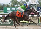 "By the Moon splashes to the win in the Frizette Stakes.<br><a target=""blank"" href=""http://photos.bloodhorse.com/AtTheRaces-1/At-the-Races-2014/i-TW2nDSg"">Order This Photo</a>"