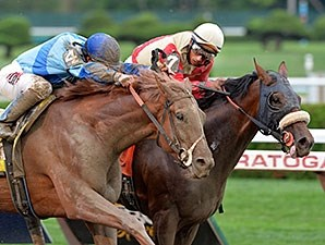 V E Day and Wicked Strong in the Travers Stakes.