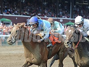 V. E. Day and Jose Lezcano get up late to win the Curlin Stakes.