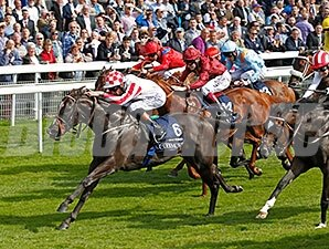 Sole Power comes on late to take the Coolmore Nunthorpe Stakes.