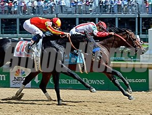 Central Banker outfinishes Shakin It Up to win the Churchill Downs Stakes.