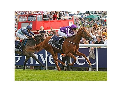 "Australia pulls away from Kingston Hill to win the Investec Epsom Derby.<br><a target=""blank"" href=""http://photos.bloodhorse.com/AtTheRaces-1/At-the-Races-2014/i-XhWVQh9"">Order This Photo</a>"