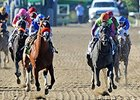 "Goldencents (left) leads all the way to win the Breeders' Cup Dirt Mile.<br><a target=""blank"" href=""http://photos.bloodhorse.com/BreedersCup/2013-Breeders-Cup/Dirt-Mile/33149801_zx584H#!i=2876404256&k=kkMtPc3"">Order This Photo</a>"