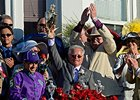 Art Sherman holds the Kentucky Derby trophy.