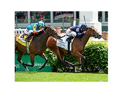 "Coffee Clique comes home strong to win the Churchill Distaff Turf Mile.<br><a target=""blank"" href=""http://photos.bloodhorse.com/AtTheRaces-1/At-the-Races-2014/i-4D7SpsN"">Order This Photo</a>"