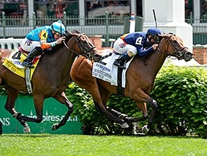 Coffee Clique comes home strong to win the Churchill Distaff Turf Mile.