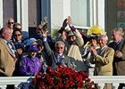"California Chrome's connections celebrate his victory.<br><a target=""blank"" href=""http://photos.bloodhorse.com/TripleCrown/2014-Triple-Crown/Kentucky-Derby-140/i-JjX27bg"">Order This Photo</a>"