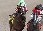 "Untapable (left) makes her move in the Rachel Alexandra.<br><a target=""blank"" href=""http://photos.bloodhorse.com/AtTheRaces-1/At-the-Races-2014/35724761_2vdnSX#!i=3088418865&k=jv59xxq"">Order This Photo</a>"