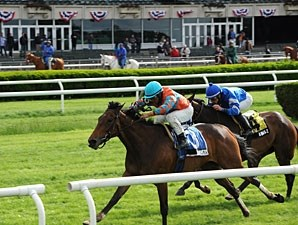 Anjaz finishing second to Tannery in the Sheepshead Bay Stakes.