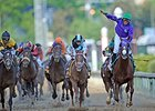"California Chrome wins the Kentucky Derby.<br><a target=""blank"" href=""http://photos.bloodhorse.com/TripleCrown/2014-Triple-Crown/Kentucky-Derby-140/"">Order This Photo</a>"