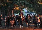 "California Chrome attracts a crowd on Thursday morning.<br><a target=""blank"" href=""http://photos.bloodhorse.com/TripleCrown/2014-Triple-Crown/Belmont-Stakes-146/i-pDHnW5R"">Order This Photo</a>"
