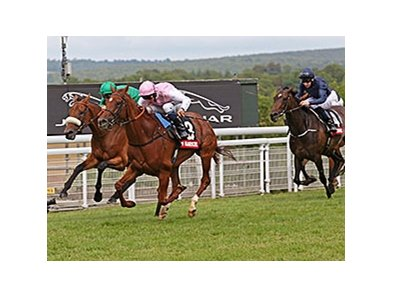"Sultanina comes home strong to take the Nassau Stakes.<br><a target=""blank"" href=""http://photos.bloodhorse.com/AtTheRaces-1/At-the-Races-2014/i-Sf3QxsN"">Order This Photo</a>"