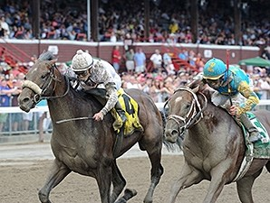 Big Trouble (left) outfinishes Mr. Z to take the Sanford Stakes.