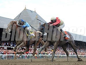 V. E. Day (right) and Wicked Strong finished 1-2 in the Travers.
