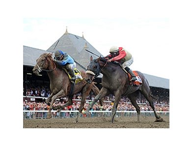 "V. E. Day (right) and Wicked Strong finished 1-2 in the Travers.<br><a target=""blank"" href=""http://photos.bloodhorse.com/AtTheRaces-1/At-the-Races-2014/i-J6K27PF"">Order This Photo</a>"