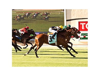 Enterprising and jockey Mike Smith, outside, nose out Argyle Cut, inside, to win the 2014 Oceanside Stakes.