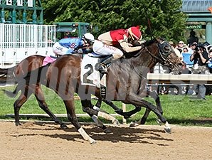 Bourbonize gets up late to win the Northern Spur Stakes at Oaklawn Park.