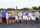 The jockey colony gathers around Jose Gutierrez to celebrate his 1000th win.