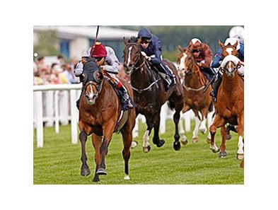 Olympic Glory pulls away to take the JLT Lockinge Stakes.