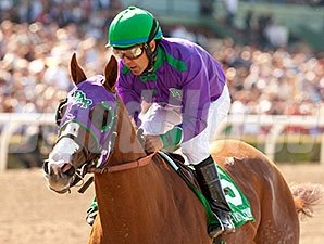 California Chrome and Victor Espinoza cruise to victory in the Santa Anita Derby.