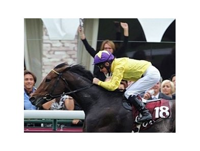 Irish jockey Mick Kinane crosses the finish line on Sea The Stars and wins the 88th edition of the Arc de Triomphe at Longchamp in Paris