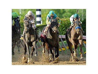 "Revolutionary (left) comes from way back to win the Pimlico Special.<br><a target=""blank"" href=""http://photos.bloodhorse.com/AtTheRaces-1/At-the-Races-2014/i-ZzZcvFx"">Order This Photo</a>"