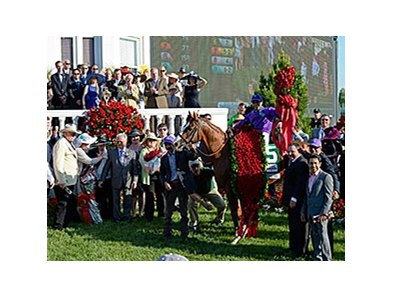 California Chrome and connections in the winnners circle.