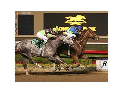 Grand Contender outfinishes Taptowne to win the Texas Mile.