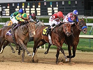 Embellishing Bob (center) was awarded the 2014 Derby Trial win after Bayern (inside) was disqualified.