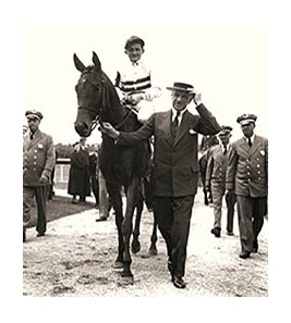 E. R. Bradley with champion 3-year-old filly, Black Helen.