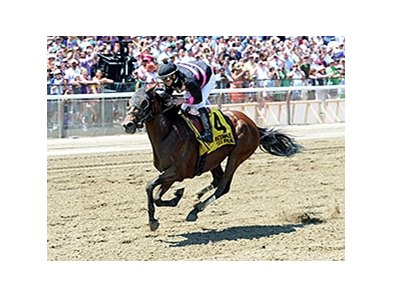 "Kid Cruz comes home strong to win the Easy Goer Stakes.<br><a target=""blank"" href=""http://photos.bloodhorse.com/AtTheRaces-1/At-the-Races-2014/i-tMWvFfT"">Order This Photo</a>"