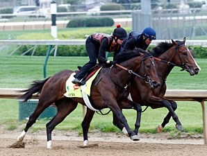 Orb works at Churchill Downs with Overwhelming on the inside.