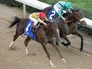 Tiago (inside) gets the nod over Heatseeker in the Oaklawn Handicap.