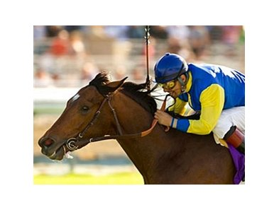 Tiz West and jockey Victor Espinoza prevail in the La Puente Stakes at Santa Anita.