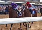 Mythical Power (left) outfinishes Euroears to win the Texas Mile.