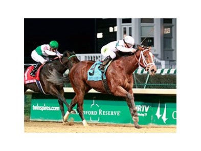 Gemologist takes control in the Kentucky Jockey Club Stakes at Churchill Downs.