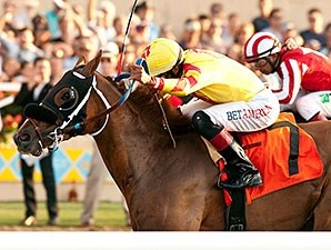 Red Outlaw wins the 2014 Real Good Deal Stakes.