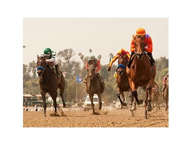 Beholder runs away from the field in the Santa Anita Oaks.
