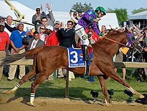 California Chrome wins the Preakness Stakes.