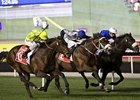 Jakkalberry (left, outside) goes by Await the Dawn and Cavalryman to win the Dubai City Of Gold.