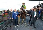 Palace Malice being led into the winner's circle by Cot Campbell.