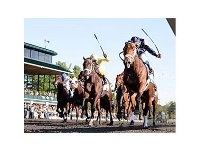 Racing on Keeneland's synthetic surface.