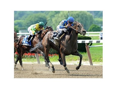 "Emma's Encore rolls by them all late to win the Victory Ride Stakes.<br><a target=""blank"" href=""http://photos.bloodhorse.com/AtTheRaces-1/at-the-races-2012/22274956_jFd5jM#!i=1951074590&k=2RrMrG2"">Order This Photo</a>"