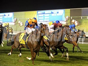 Steele Tango (left, orange/blue silks) wins the 2011 Dubai Duty Free Millennium Millionaire.
