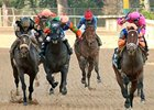Oxbow and Gary Stevens (far left) finished 5th behind Overanalyze (far right) in the Arkansas Derby.