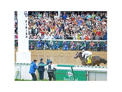 Super Saver crosses the finish line to win the Kentucky Derby.