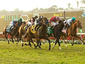 Favored at 2-1, Whatsthescript wins the Del Mar Mile Handicap (gr. IIT).