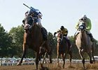 Silent Valor (left) takes the Sapling (gr. III) at Monmouth Park.