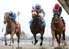 Snuggs and Kisses (right) fights off Daisy Devine to win the Bayou Handicap.